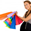 Smiley girl with shopping bags — Stock Photo