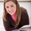 Relaxed woman studying — Stock Photo