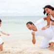 Beach family pulling a rope — Stock Photo