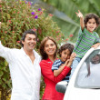 Family with a car — Stock Photo