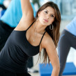Gym woman exercising - Stock Photo