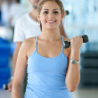 Womlifting free weights — Stock Photo #7708092