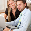 Business couple on a laptop — Stock Photo #7708137
