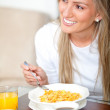 Woman eating her breakfast — Stock Photo