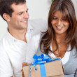 Couple with a present — Stock Photo