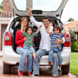 Family with a car — Stock Photo #7708292