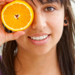 Woman with an orange — Stock Photo #7708315