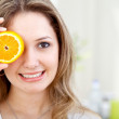 Woman with an orange — Stock Photo