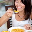 Woman eating her breakfast — Stock Photo #7708471