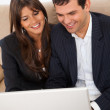 Stock Photo: Business couple on a laptop