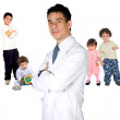 Pediatrician with children — Stockfoto