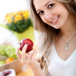 Woman with an apple — Stock Photo #7708607