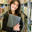Student at a library — Stock Photo