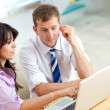 Business couple on a laptop — Stock Photo #7708715