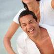 Happy beach couple - Stock Photo