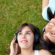 Women listening to music — Stock Photo