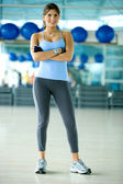 Beautiful woman at a gym — Stock Photo