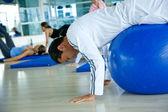 Gym man doing pilates — Stock Photo