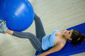 Gym woman doing pilates — Stockfoto
