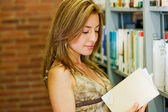 Girl in a library — Stock Photo