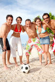 Football team at the beach — Stock Photo