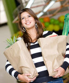Woman at the supermarket — Stock Photo