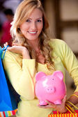 Shopping woman saving money — Stock Photo