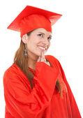 Thoughtful graduation woman — Stock Photo