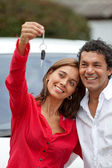 Couple with their new car — Stock Photo
