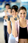 Woman with free weights — Stock Photo