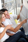 Couple with the newspaper — Stock Photo