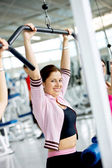 Gym woman exercising — Stockfoto