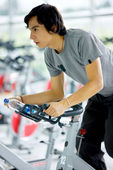 Man doing spinning in a gym — Stock Photo