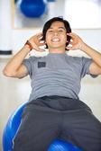 Man doing sit-ups — Stock Photo