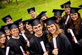 Happy graduates — Stock Photo