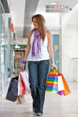 Woman with bags — Stockfoto