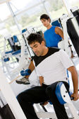 Man at the gym - weights — Stockfoto