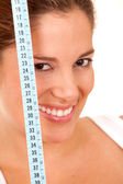 Woman with measuring tape — Stock Photo