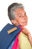 Beautiful elderly woman with shopping bags — Stockfoto