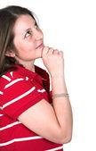 Beautiful casual girl in red - pensive — Stock Photo