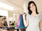 Clothes shopping girl — Stock Photo