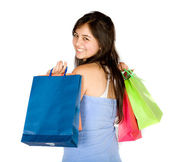 Beautiful teenager with shopping bags — Стоковое фото