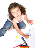 Girl colouring a drawing — Stock Photo