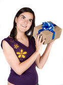 Girl wondering what she got for a gift — Stock Photo