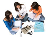 Beautiful students studying on the floor — Stock Photo