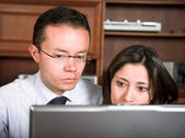 Business couple on laptop — Stock Photo