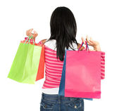 Girl in pink holding shopping bags — Stock Photo