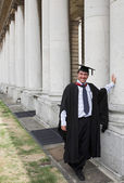Casual graduate - columns — Stock Photo
