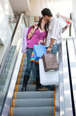 Loving couple on escalators — Stock Photo
