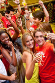Friends at a bar — Stock Photo
